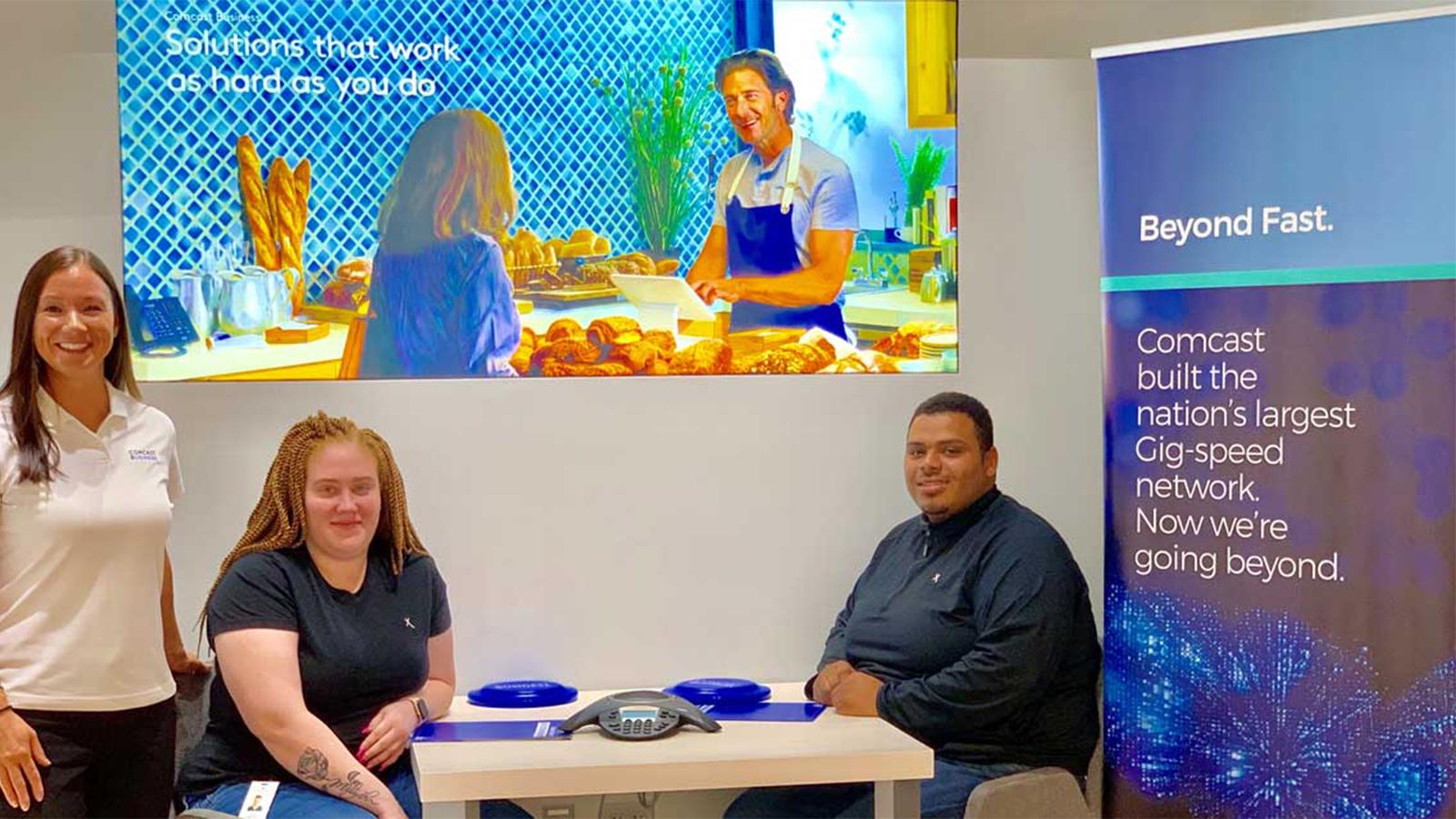 Jerilynn Davidge and team members at an Xfinity store.
